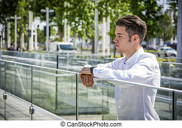 Attractive young man in city