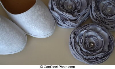 White bride shoes and bridal accessories.