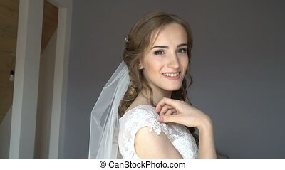 Beautiful bride on your wedding day in the room.