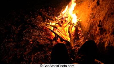 camping bonfire at dusk close up