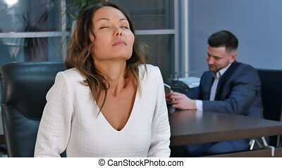 Young asian business woman relax after work, doing exercises...