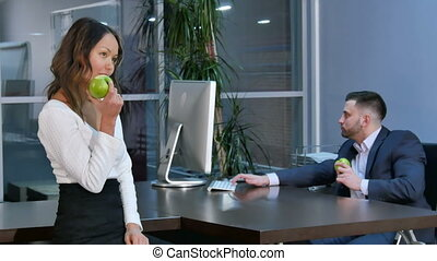 Business people having lunch, eating green apples....