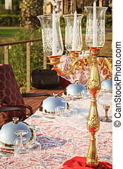 Special occasion table setting in a luxury outdoor...