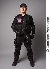North Korean Commando on gray background.