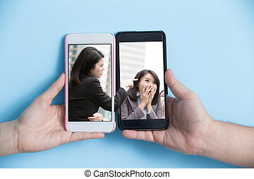 internet bullying concept - hand take smart phone with...