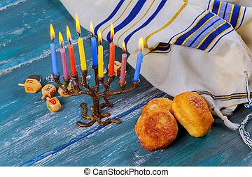 Jewish holiday hanukkah with sufganiyah and menorah