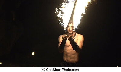 Handsome man with fire - Handsome man doing fires how at the...