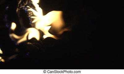 Fire flames isolated on black background - video in slow...