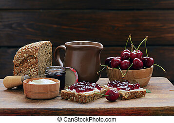 Sandwich with cherry jam and soft cheese