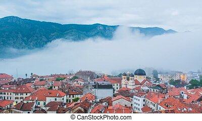 Fog over the old town of Kotor, Montenegro. The fog covers...