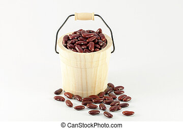 Wooden cask of red beans isolated