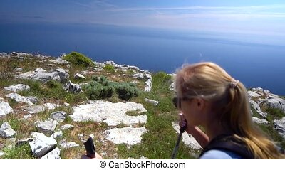 Young woman hiking in mountains over Amalfi coast. Slow...