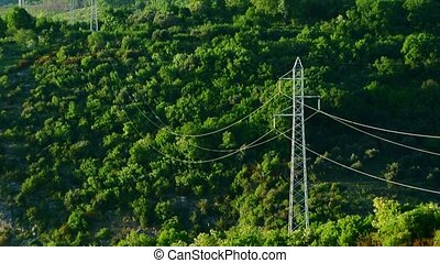 Line of high-voltage poles in the mountains of Montenegro.