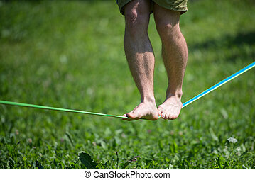 Walk in balance on rope barefoot
