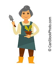 Elderly woman in apron with plant and trowel - Elderly grey...