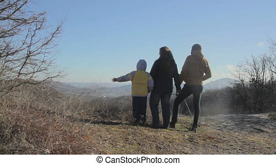 Family Stay on the hillside and look to the autumn valley....