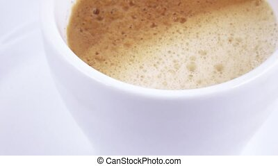 White cup with coffee - Rotating a white cup with coffee