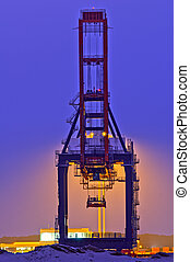 Quay Crane - Backlit container crane in the Port of...
