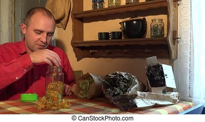 Happy country man sort dried marigold calendula blooms herbs...
