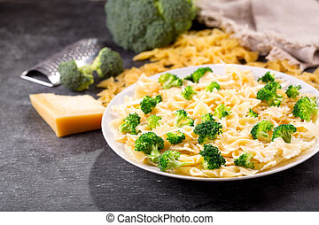 plate of pasta with broccoli and parmesan