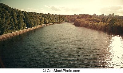 Aerial shot of the Moscow river and Fili park riversides on a sunny day