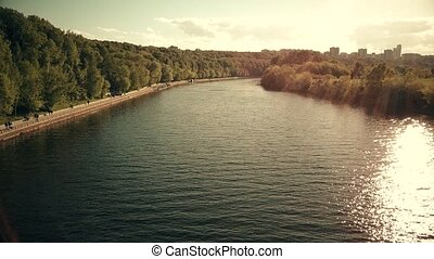 Aerial shot of the Moscow river and Fili park riversides on...