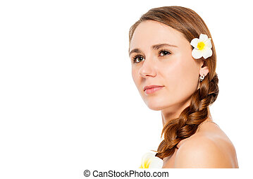 Close-up of a woman's face with flowers in her hair on a white background isolated