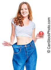 Woman with an apple in her hand supports a large size of old...