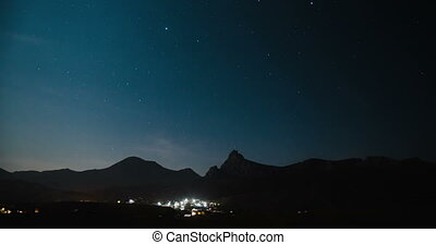 Night sky with stars over the mountain valley