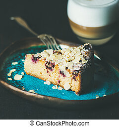 Piece of cake and glass of latte, square crop - Dessert and...