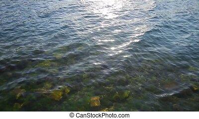 Texture of water. Adriatic Sea near Montenegro. Transparent...
