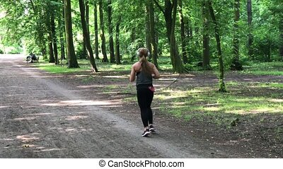 Young female jogger with headphones - Young female jogger in...