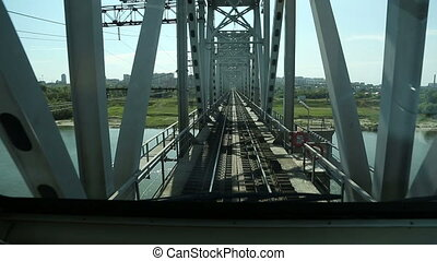 train rides on the bridge over the river. The view from the...