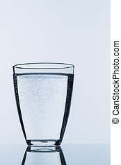 a glass of water against white huintergrund, symbolfoto for...