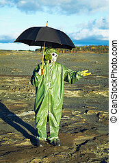 Man in gas mask with umbrella waiting for acid rain - Man in...