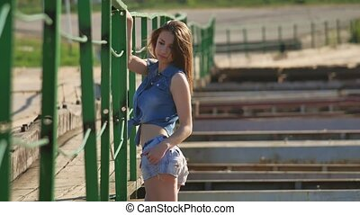 Girl and bridge lifestyle. Beautiful sexy girl is standing...
