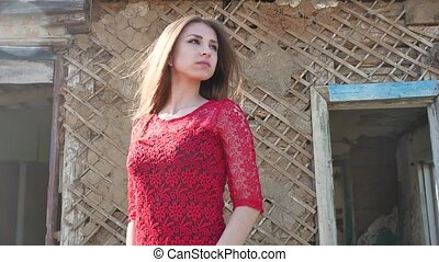 Beautiful girl lifestyle in a red dress. Sexy girl in a...