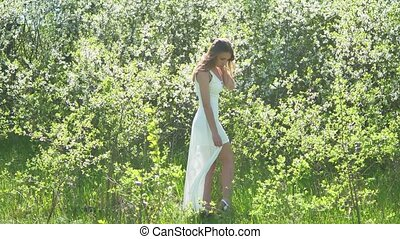 Girl and blooming cherry. The girl is standing in nature...