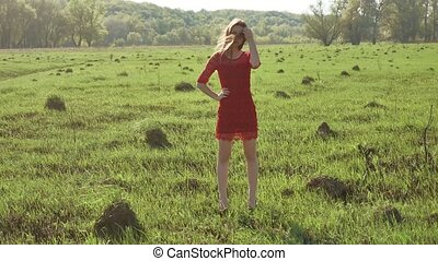 Girl wind nature. girl is standing in the field of grass green. lifestyle woman freedom