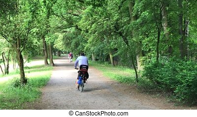 Men riding in the park