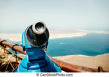 Telescope and panoramic view at La Graciosa Island from...