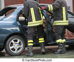 Firefighter training to extract trapped man in the car
