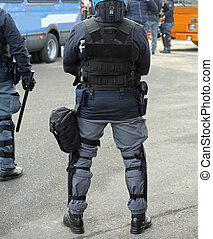 police in riot gear with batons during a protest i