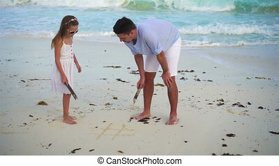 Father and little girl at tropical beach - Happy father and...