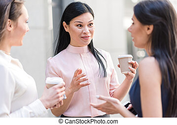 Surprised female telling with coworkers - Lady demonstrating...