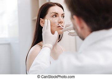 Delicate careful beautician minimizing the signs of age - No...