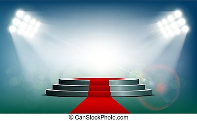 Round podium with a red carpet is illuminated with...