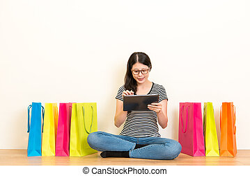 pretty asian woman shopping online at home