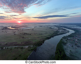 aerial view of river at sunrise