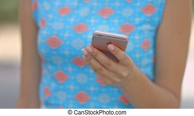 Closeup of woman hands using a smartphone - Closeup of young...